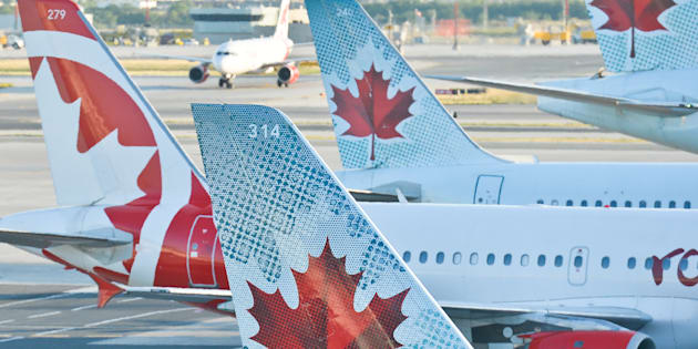 A view of Air Canada planes at Toronto's Pearson International Airport, Wed. July 20, 2016. Air Canada has confirmed a system outage is leading to service interruptions as angry passengers take to Twitter to complain about long lines and flight delays during the March break travel rush.