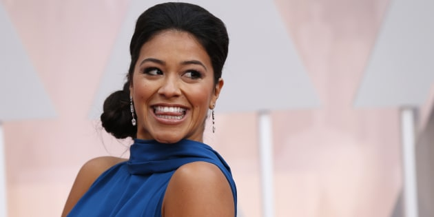 """Actress Gina Rodriguez, wearing a bright blue Manon Gabard gown, arrives at the 87th Academy Awards in Hollywood, California February 22, 2015. Rodriguez recently won a Golden Globe for her role in """"Jane the Virgin."""""""