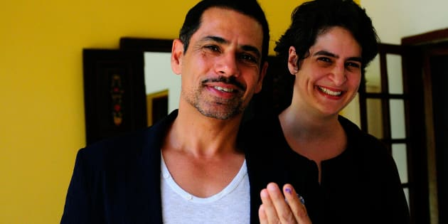 NEW DELHI, INDIA - APRIL 10: Robert Vadra with his wife Priyanka Gandhi showing vote marks on his finger after casting votes for general election of the 16th Lok Sabha 2014 on April 10, 2014 in New Delhi, India. (Photo by Priyanka Parashar/Mint via Getty Images)