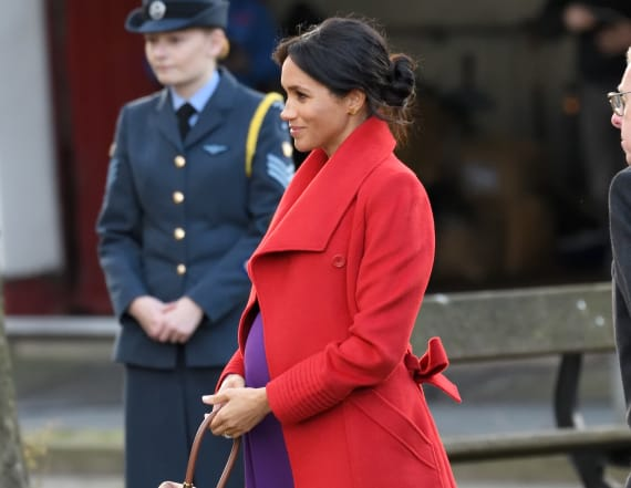 Meghan stuns in purple and red for Birkenhead visit