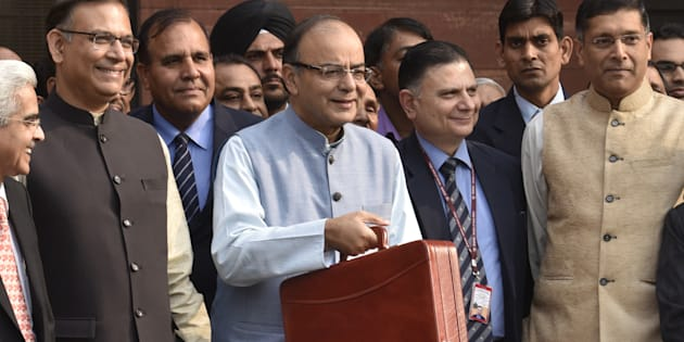 Union Finance Minister Arun Jaitley with Minister of State Jayant Sinha leaving Finance Ministry North Block to present the General Budget at Parliament House, on February 29, 2016 in New Delhi, India.