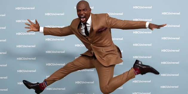 """Terry Crews of """"Brooklyn Nine-Nine"""" leaps as he poses for photographers at the NBCUniversal UpFront presentation in New York City on May 14, 2018."""