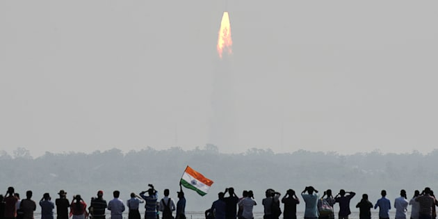 Indian onlookers watch the launch of the Indian Space Research Organisation (ISRO) Polar Satellite Launch Vehicle (PSLV-C37) at Sriharikota on Febuary 15, 2017.