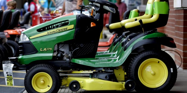 A Deere & Co. John Deere riding lawn mower sits for sale outside a Lowe's store in Wake Forest, North Carolina, U.S., on Saturday, Aug. 14, 2010.