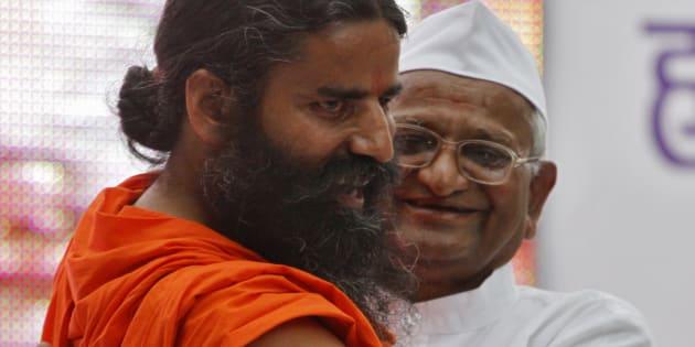 File photo of Indian yoga teacher Swami Ramdev (L) with veteran social activist Anna Hazare.