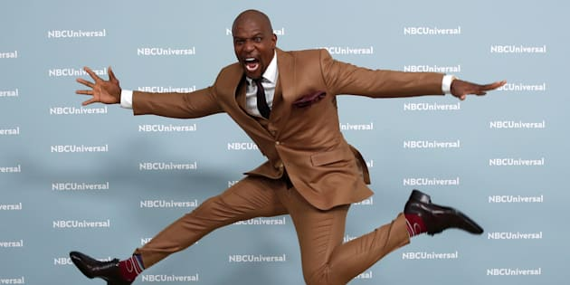 "Terry Crews of ""Brooklyn Nine-Nine"" leaps as he poses for photographers at the NBCUniversal UpFront presentation in New York City on May 14 2018."
