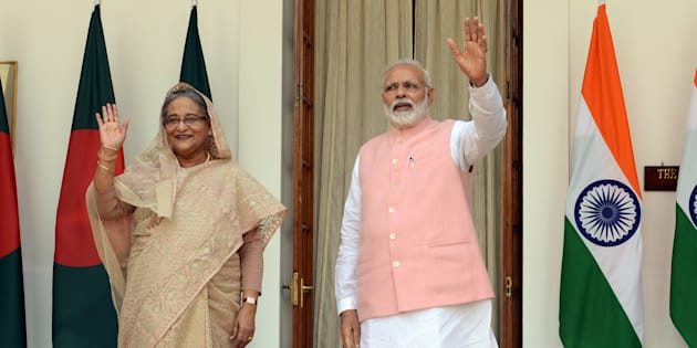 Indian Prime Minister Narendra Modi and Bangladesh Prime Minister Sheikh Hasina pose for the media prior to a meeting in New Delhi.