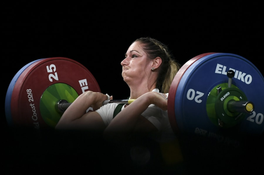Mona Pretorius of South Africa lifts on the way to winning the bronze medal in the women's 63kg weightlifting.