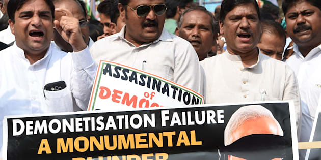 Indian Congress Party supporters shout slogans during a protest against demonetisation at the Reserve Bank of India in Mumbai on January 18, 2017.