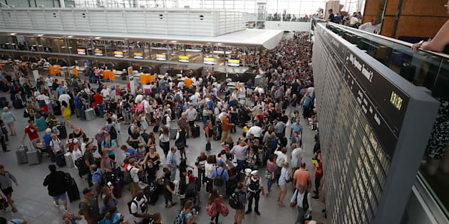 Passengers wait for their flights in Terminal 2, after it has been temporarily closed due to a police operation, at Munich's international Airport, Germany, July 28, 2018. REUTERS/Michael Dalder