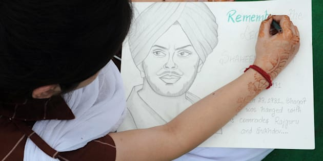 An Indian school girl draws a portrait of the historical Indian freedom fighter Shaheed Bhagat Singh during an art competition at Jallianwala Bagh in Amritsar on April 13, 2012.