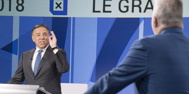 CAQ leader Francois Legault, left, questions Liberal leader Philippe Couillard during the leaders debate Sept. 13, 2018 in Montreal.