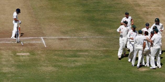 FILE PHOTO: Australia's players celebrate the wicket of India's captain Virat Kohli at the Maharashtra Cricket Association Stadium, Pune.