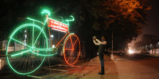 Giant model of Samajwadi Party symbol 'Bicycle' with LED lights.