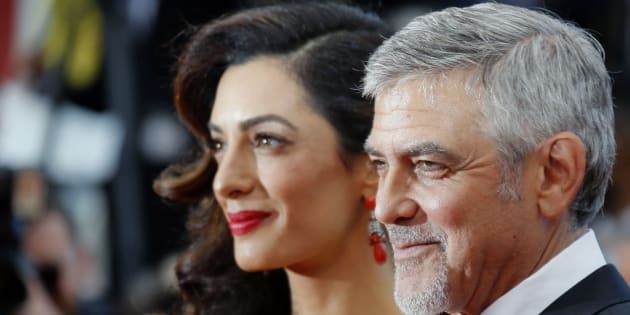 Actor George Clooney and wife Amal Clooney arrive at The Universal Premiere of Hail, Caesar! at the Regency Village Theatre, in Westwood, California, February 1, 2016 / AFP / Valerie Macon        (Photo credit should read VALERIE MACON/AFP/Getty Images)