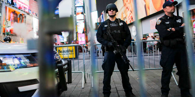 New York Police Department officers stand guard in Times Square on May 29, 2017.