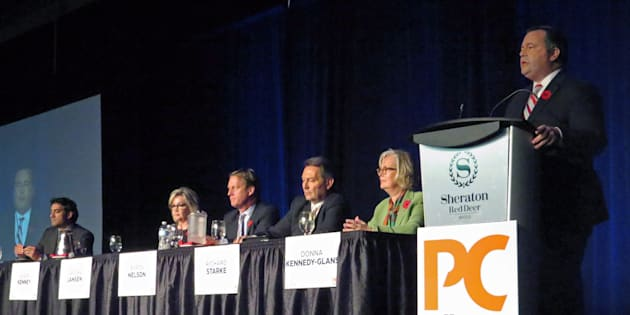 Former Conservative MP Jason Kenney speaks at the Alberta Progressive Conservative party leadership forum while the other five leadership candidates, Stephen Khan, left to right, Sandra Jansen, Byron Nelson, Richard Starke and Donna Kennedy Glans listen in Red Deer on Nov. 5, 2016.