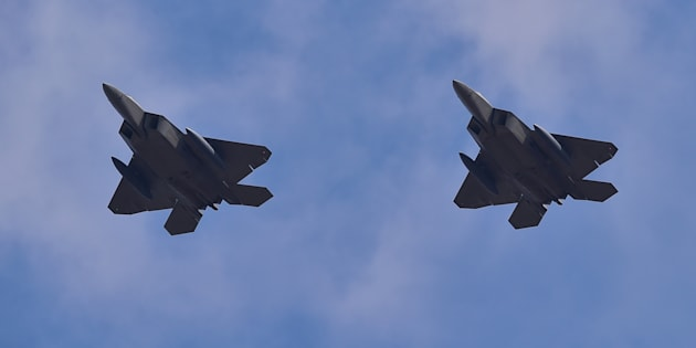 US F-22 stealth fighters fly over Osan Air Base in Pyeongtaek, south of Seoul, on February 17, 2016.