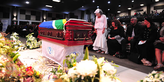 Simphiwe Ngema stands in front of her late husband Dumi Masilela's coffin during his funeral service at Hope Restoration Ministries on August 12, 2017, in Kempton Park.