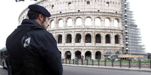 ROME, ITALY - NOVEMBER 23: Italian Policeman outside the Colosseum for security checks two weeks before the start of the Jubilee on November 23, 2015 in Rome, Italy.  PHOTOGRAPH BY Marco Ravagli / Barcroft Media  UK Office, London. T +44 845 370 2233 W www.barcroftmedia.com  USA Office, New York City. T +1 212 796 2458 W www.barcroftusa.com  Indian Office, Delhi. T +91 11 4053 2429 W www.barcroftindia.com (Photo credit should read Marco Ravagli / Barcroft Media / Barcroft Media via Getty Images)