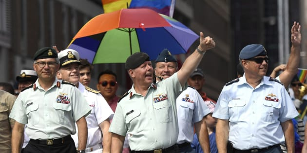 Chief of the Defence Staff Jonathan Vance, centre, marches in the Ottawa Capital Pride parade on Aug. 27, 2017.