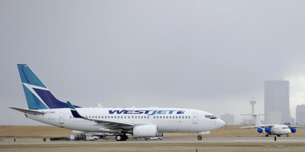 A Westjet Boeing 737-700 takes off at the International Airport in Calgary, Alberta.