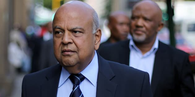 South Africa's Finance Minister Pravin Gordhan walks with his deputy, Mcebisi Jonas as they walk from their offices to a court hearing in Pretoria, South Africa, March 28, 2017.
