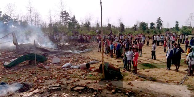 People gather near the site of a fire that took place in firecrackers factory at Balaghat, Madhya Pradesh on 7 June.