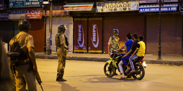 SRINAGAR, KASHMIR, INDIA - JULY 10: Indian government forces a motorcyclist in the City center to stop during a curfew after 21 people were killed and more than 400 Injured on July 10, 2016 in Srinagar, the summer capital of Indian Administered Kashmir. The has been more violence in Indian-administered Kashmir after separatist rebel Burhan Wani, 22, was killed in a gunfight with the Indian army on Friday. (Photo by Yawar Nazir/ Getty Images)