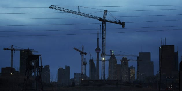 "Construction cranes along the skyline in Toronto, Dec. 6, 2012. The slowdown in Canada's housing market will get worse before it gets any better, a new analysis predicts, because the country is about to be flooded with a ""huge amount"" of new homes."