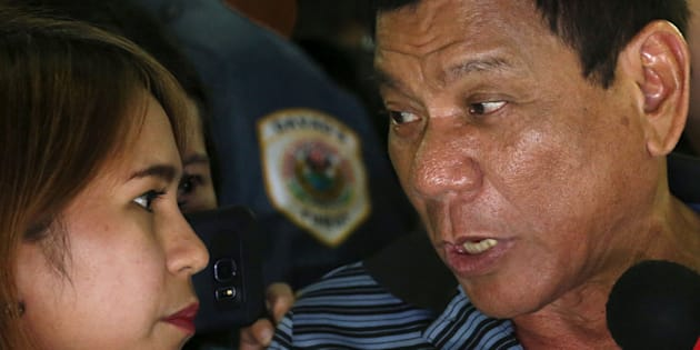 Presidential candidate Rodrigo Duterte talks to a reporter during an election campaigning for May 2016 national elections in Silang, Cavite southwest of Manila, Philippines April 22, 2016.    REUTERS/Erik De Castro/File Photo         SEARCH ÒDUTERTE PRESIDENCYÓ FOR ALL IMAGES