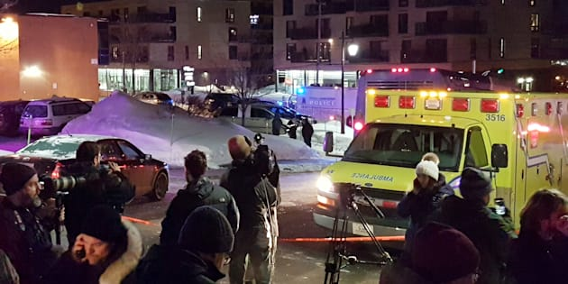 An ambulance is parked at the scene of a fatal shooting at the Quebec Islamic Cultural Centre in Quebec City.