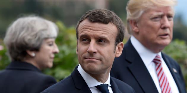 La primera ministra británica, Theresa May, y el presidente de EEUU, Donald Trump, al fondo, con el presidente de Francia, Emmanuel Macron, en primer término, el pasado mayo en la reunión del G7 en Sicilia.