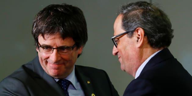El expresident de la Generalitat, Carles Puigdemont, y su sucesor, Quim Torra.