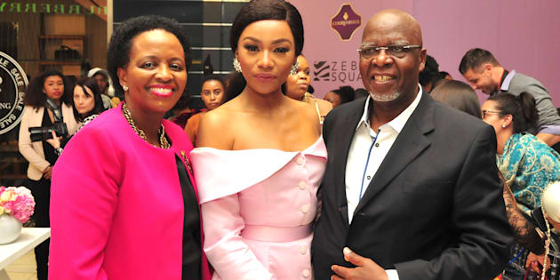 Bonang Matheba poses with her parents Andrew Gampi Matheba and Charlotte during her book launch at Sandton City's Diamond Walk on August 03.