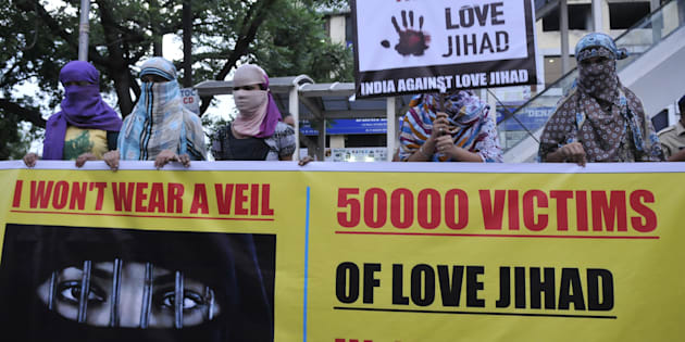 Women associated with India Against Love Jihad hold placards and form a human chain to protest against love jihad and conversion to Islam at MP Nagar on September 12, 2014 in Bhopal, India.