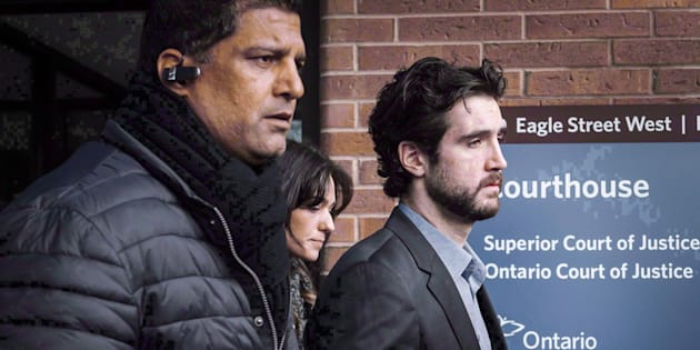 Marco Muzzo, right, leaves the Newmarket courthouse surrounded by family, on Feb. 4, 2016.