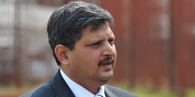 Atul Gupta stands outside the Randburg Magistrate's court on September 27, 2010 in Johannesburg, South Africa.