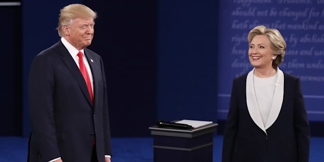 ST LOUIS, MO - OCTOBER 09:  Republican presidential nominee Donald Trump (L) and Democratic presidential nominee former Secretary of State Hillary Clinton stand on stage during the town hall debate at Washington University on October 9, 2016 in St Louis, Missouri. This is the second of three presidential debates scheduled prior to the November 8th election.  (Photo by Win McNamee/Getty Images)