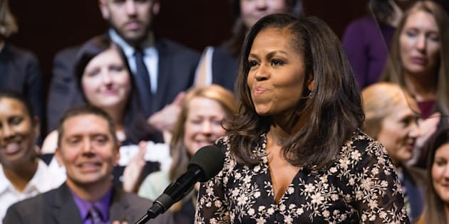 Former U.S. First Lady Michelle Obama presented the 2018 School Counselor of the Year award to Kristen Perry of Chicago, Ill., at the John F. Kennedy Center for the Performing Arts in Washington, D.C., on Feb. 2, 2018.