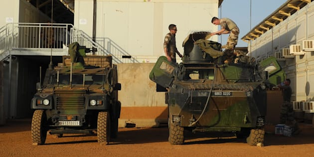 Soldiers of France's Barkhane mission stand next military vehicles on the military base in Gao, Mali on October 31, 2017.