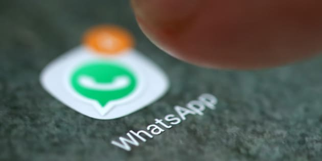 The WhatsApp app logo is seen on a phone in this picture illustration taken Sept. 15, 2017.