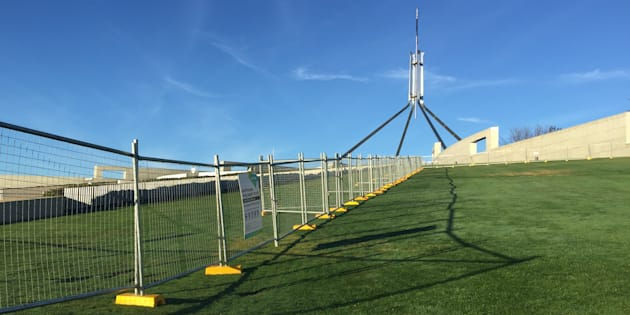 A temporary Parliament House security fence in readiness for a permanent one.