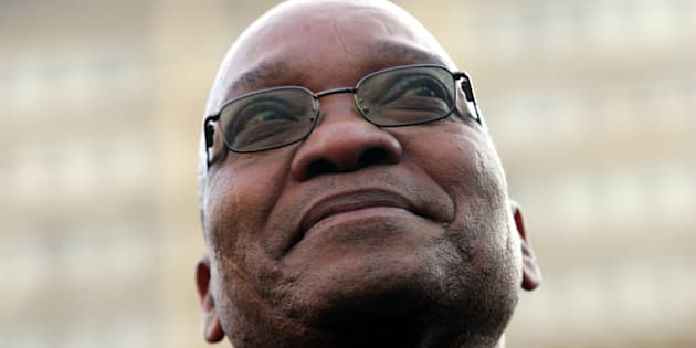 Former South African deputy-President Jacob Zuma smiles at supporters after his acquittal on rape charges, in the Johannesburg High Court May 8, 2006. A South African judge on Monday acquitted Zuma of raping an HIV-positive family friend, ending a case that opened deep rifts in the ruling African National Congress.