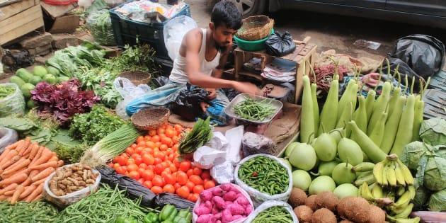 A vegetable seller in Kolkata. (Photo by Debajyoti Chakraborty/NurPhoto via Getty Images)