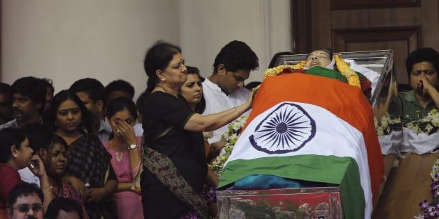 Sasikala Natarajan next to Chief Minister J Jayalalithaa's body in Chennai, on 6 December 2016. (AP Photo/Aijaz Rahi)