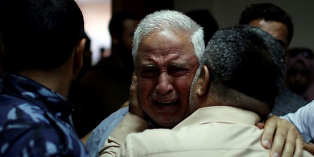A relative of Palestinian Ahmed al-Rantisi, who was killed during a protest at the Israel-Gaza border, is consoled at a hospital in northern Gaza. May 14 2018.