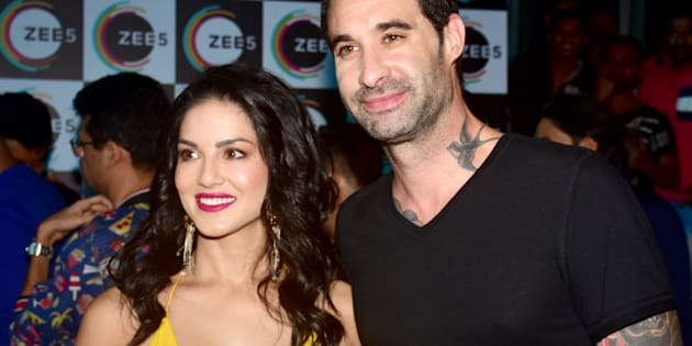 MUMBAI, MAHARASHTRA, INDIA - 2018/07/09: American-Canadian-Indian actress Sunny Leone with husband Daniel Weber pose for picture on the event where her Biopic 'Karenjit Kaur' launch in Mumbai. (Photo by Azhar Khan/SOPA Images/LightRocket via Getty Images)