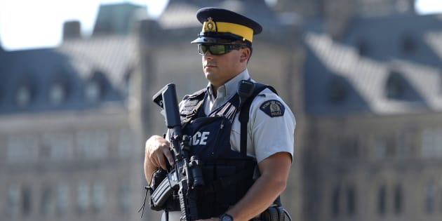 An armed RCMP officer stands on Parliament Hill, a day after an RCMP incident involving Aaron Driver in Strathroy, Ont., on Thursday, Aug. 11, 2016 in Ottawa.