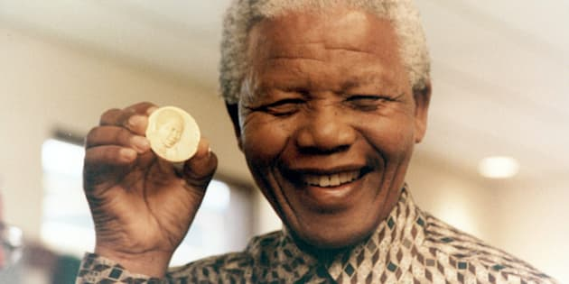 Former president Nelson Mandela in a file photo at the South African Mint where the first presidential coin was launched. It depicts the inauguration of Mandela in 1994.